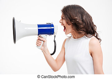 Woman screaming into megaphone - Side view portrait of a...