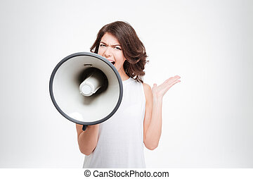 Beautiful woman shouting into megaphone isolated on a white...