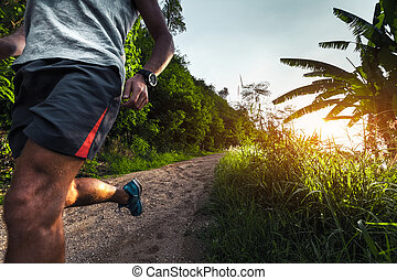 Man jogging on the road - Man jogging on the gravel road at...