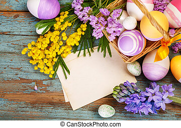 Easter decorations on a wooden background