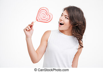 Cheerful woman holding lollipop isolated on a white...