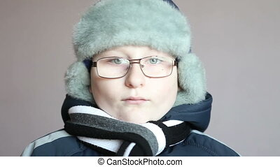 Boy in winter clothes looking at the camera