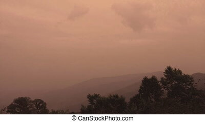 sunrise timelapse of mountain heights with dense layer of...