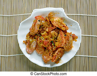 Shrimp DeJonghe specialty of Chicago, is a casserole of...