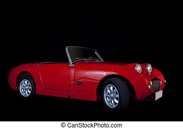 Little Red Sportscar - Small red vintage sportscar in studio...