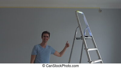 person is happy with his new appartment - worker standing...