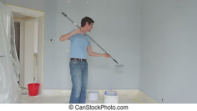 worker having fun with renovating utensil - decorator...