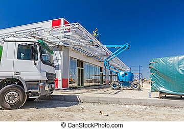 Blue cherry picker. Boom lift. - High elevated cherry picker...