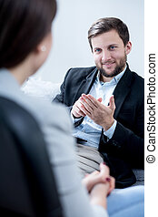 Giving an advice - Psychotherapist giving an advice to young...