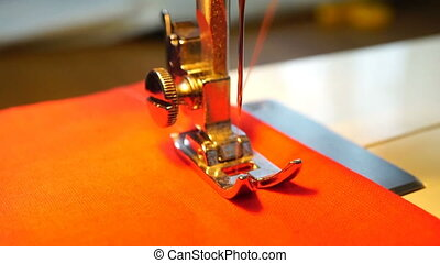 video of woman sews on the sewing machine