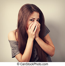 Happy laughing young woman cover two hands her mouth with...