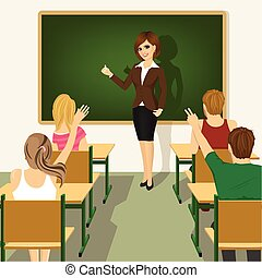 rear view of school lesson with students and teacher in classroom with green chalkboard and desks