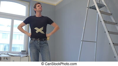 finished work at home - person having a cross on his t-shirt...