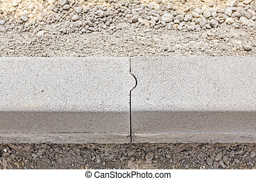 Detail on newly installed curb.
