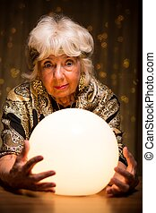 Fortuneteller looking into crystal ball - Fortuneteller...