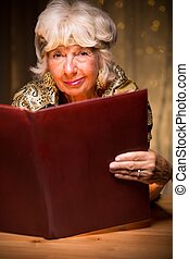 Eccentric lady with a book - Eccentric elderly lady with a...