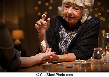 Woman visiting a fortune teller to know her future