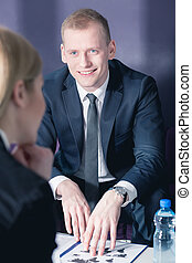 Let me present you our offer - Businessman in suit during...