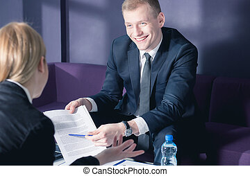 Please, sign here... - Businessman in suit during business...