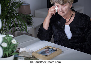 Crying after husband - Old woman crying after death of her...
