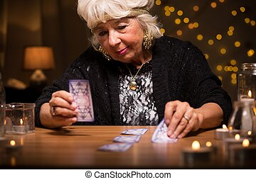 Predicting future from cards - Old woman predicting future...