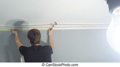 man renovating his new home - close-up of man standing on...