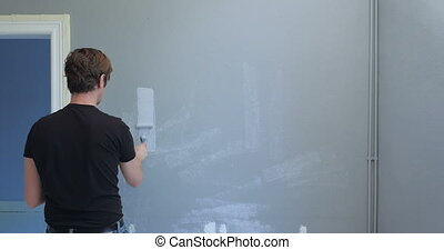 man painting old wall