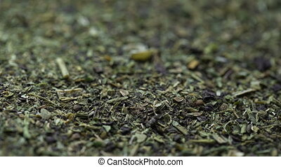 The dry mixture of spices. Parsley basil dill. Macro smooth...