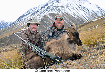 Successful hunters with a Himalayan tahr in the Southern...