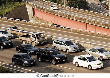 Traffic jam on the highway with cars.