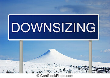 Road sign with text Downsizing - A blue road sign with white...