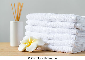 Aromatic spa with home diffuser and white towel