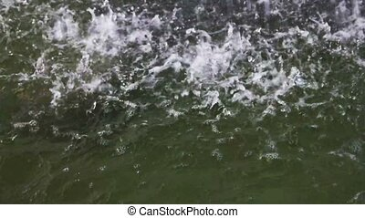 Disturbed water surface by falling water dropst. Slow motion...
