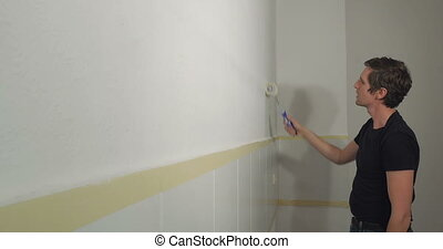 man enjoy painting work - happy man at home enjoy doing...