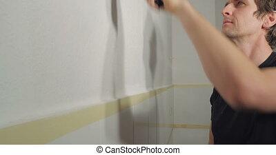 man enjoy painting work