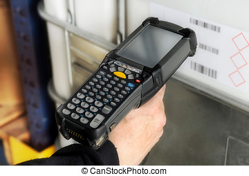 Person scanning a barcode with a scanner - Person scanning a...