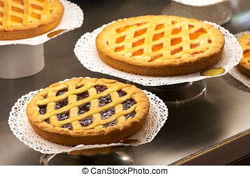 Display of freshly baked tarts in a bakery