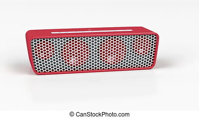 Red wireless speaker on shiny white background