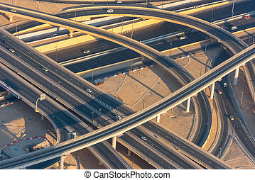 Top view of highway interchange in Dubai, UAE. Morning shot