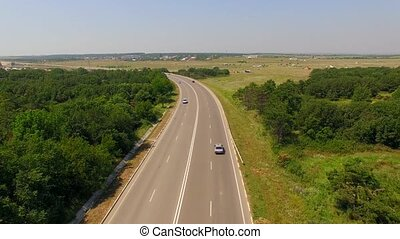 Country Route With Several Cars Moving Fast - AERIAL VIEW...