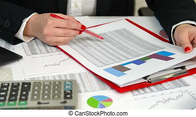 Businesswoman Checking Budget, Close Up