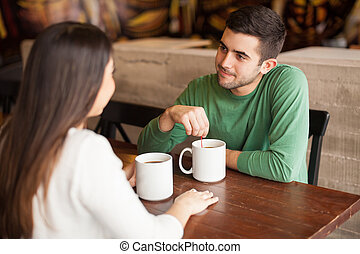 Young man having coffee with his date