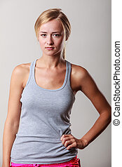 Portrait sporty woman fit fitness girl on gray.