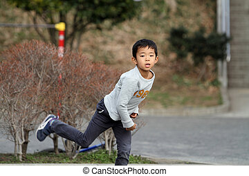 Japanese boy playing catch 6 years old