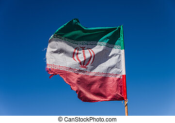 Iran flag waving in the wind in Teheran