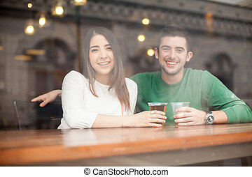 Good looking couple drinking beer at a bar - Portrait of a...