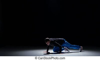 Young dancer man continue dancing breakdance, black - Young...