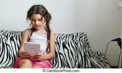 girl and tablet - teen girl playing tablet game sitting on...
