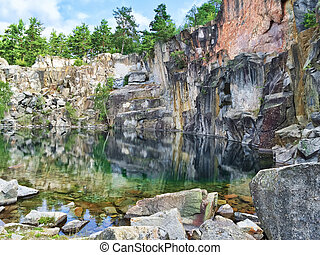 Picturesque lake in the ancient stone quarry