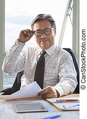 senior business man working on office table with smiling...